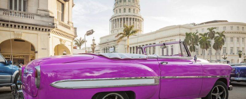 classic american car in cuban capitol
